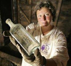 archaeologist Ellen Berkland with a bottle found at a dig on Joy Street