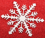 silver metal snowflake on a red background