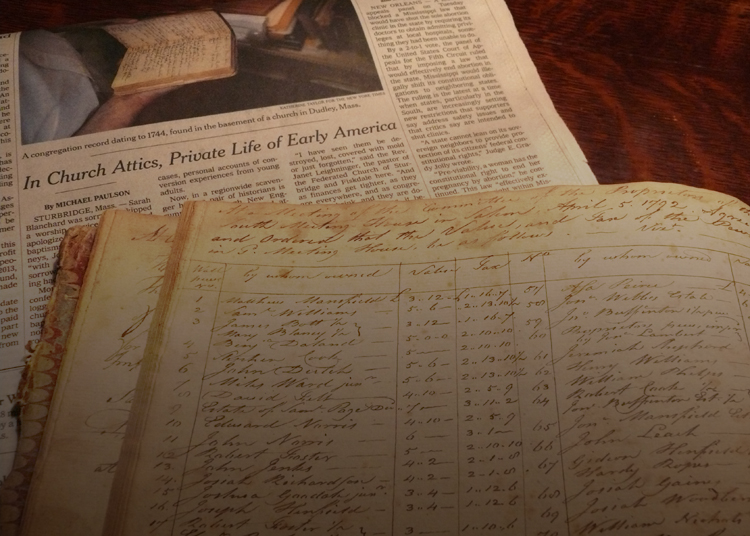 an original manuscript record book and an article about NEHH in the New York Times