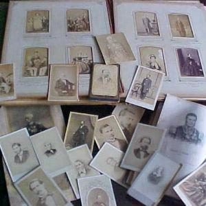 photographs scattered over a photo album and table
